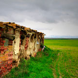 Abandoned. House in disrepair in field Stock Image