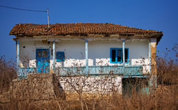 Abandoned house in Dobrogea. Turkish style abandoned house due to poverty and emigration in Dobrogea county, Romania Royalty Free Stock Photo