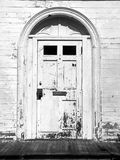 Abandoned house: door detail. Abandoned house with peeling front door Royalty Free Stock Images
