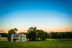 Abandoned house in a field, in rural York County, Pennsylvania. Royalty Free Stock Images