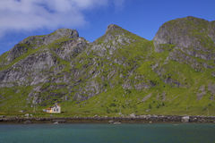 Abandoned house by fjord Stock Photos