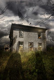 Abandoned house with flying ghosts stock photography