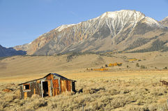 Abandoned House in Foothills. Abandoned Residence Structure in Foreground near Lee Vining, California Stock Photo