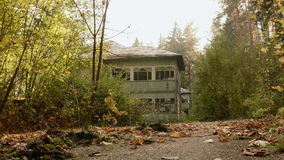 Abandoned house in the forest. Autumn daytime. Smooth dolly shot.  stock footage