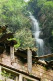 Abandoned house. In forest,waterfall on background Royalty Free Stock Photo