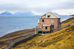 Abandoned house in the harsh arctic nature at summer Stock Photo