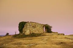 Abandoned house in the hill at sunset Royalty Free Stock Image