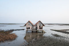 Abandoned house in inland sea. Nobody live in home Stock Images