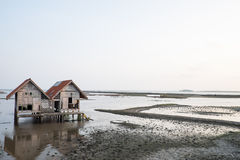 Abandoned house in inland sea. Nobody live in home Stock Image