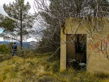 Abandoned house invaded by nature. On the mountain stock photos