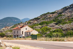 Abandoned house near a highway, Corsica Royalty Free Stock Photo