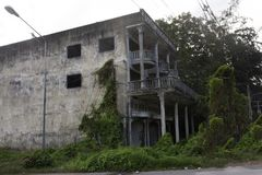 Abandoned house and old commercial building beside Ban Phe road in Rayong, Thailand stock photography