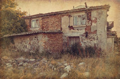 Abandoned house. Old abandoned house in the grunge and vintage style Royalty Free Stock Image