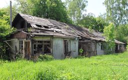 Abandoned house. Old abandoned house overgrown with grass stock image