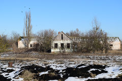 Abandoned house. The old structure of kindergarten. Winter on the abandoned buildings.  Stock Photo
