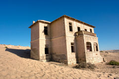 Abandoned house in sand Stock Photo