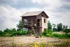Abandoned House. On sandy beach royalty free stock photo