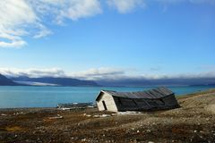Abandoned house on the shore of Greenland Sea Stock Photos