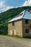Abandoned house in a small mountain village, concept - immigration, search for a better life in big cities royalty free stock image