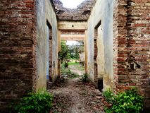 Old crumbling brick house in ruins royalty free stock image