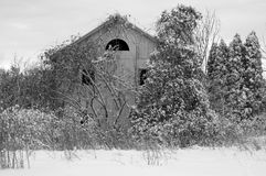 Abandoned House in Snow Stock Image