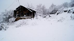 Abandoned house in the snow, winter in Russia. royalty free stock photo