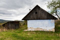 Abandoned house somewhere in rural Slovakia. Old house with wooden roof and dilapidated wall Stock Photos