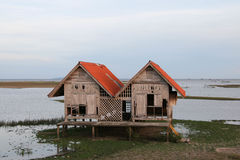 Abandoned house in Thale Noi lake at Phatthalung province,Thailand. Twin house, Abandoned house in Thale Noi lake at Phatthalung province,Thailand Stock Photo