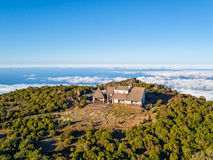 Abandoned House on Top Mountain Above the Clouds Stock Photography