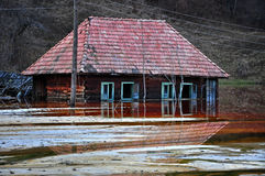 Abandoned house in a toxic lake Stock Photo