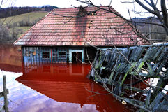 Abandoned house in a toxic lake Stock Images