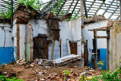 Abandoned house, Ukraine. Abandoned and devastated house in Ukraine, Donbass. Forgotten place. The concept of the fighting force and war stock images