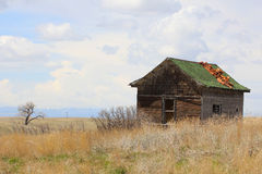 Abandoned House in Wyoming. An abandoned shack in a field in Southeastern Wyoming stock images