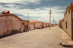Abandoned houses of a street deserted in the saltpeter Humberstone, old ghost town used to obtain infinite products derived from. Saltpeter, Atacama desert royalty free stock image