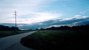 Abandoned Housing Development 2. A landscape in an abandoned housing development with a cloudy sky and vegatation Royalty Free Stock Images