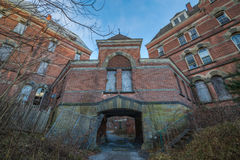 The abandoned Hudson River Psychiatric Hospital. Some of the brick buildings that make up the old Hudson River State Hospital Royalty Free Stock Photo
