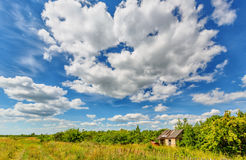 Abandoned hut beneath cloudy sky Royalty Free Stock Image