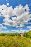 Abandoned hut beneath cloudy sky Stock Photo