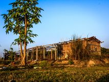 ABANDONED HUT AND BLUE SKY Royalty Free Stock Photo