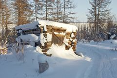 Abandoned hut in forest. Abandoned, snow-covered hut in forest stock photos