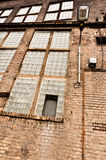 Abandoned industrial building. Angle shot of an abandoned industrial building with brick wall stock image