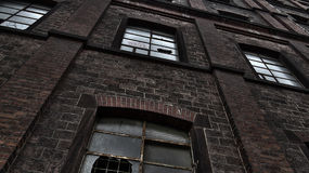 Abandoned industrial building. Exterior of abandoned industrial building with broken windows Stock Image