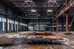 Abandoned industrial building with old rusty bridge crane and metal constructions.  stock photos