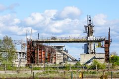 Abandoned industrial building with rusty bridge crane at scrap metal recycling metallurgical plant. For electric steel melting stock photo