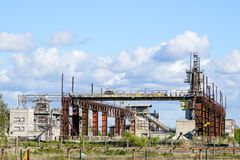 Abandoned industrial building with rusty bridge crane at scrap metal recycling metallurgical plant. For electric steel melting royalty free stock photos