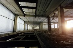 Abandoned industrial building waiting for it`s demolition or reconstruction. Or repair Royalty Free Stock Photo