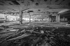 Abandoned industrial building. Wrecked interior. Black and white photo of an abandoned building. Empty, wrecked recked industrial interior royalty free stock image