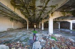 Abandoned industrial building. Wrecked interior. View of an abandoned building. Empty, wrecked recked industrial interior royalty free stock image