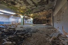Abandoned industrial building. Wrecked interior. View of an abandoned building. Empty, wrecked recked industrial interior stock image