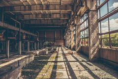 Abandoned industrial creepy warehouse inside old dark grunge factory building Stock Images